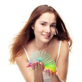 Girl playing with slinky Royalty Free Stock Image