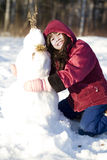 Girl playing in the snow Royalty Free Stock Image