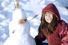 Girl playing in the snow Royalty Free Stock Photos