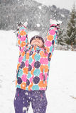 Girl playing in snow. A girl playing in the snow Royalty Free Stock Photo