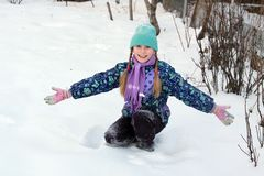 Girl playing with snow Stock Images