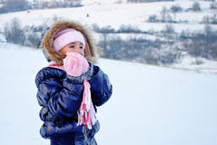Girl playing with snow royalty free stock images