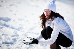 Girl playing with snow Stock Photography