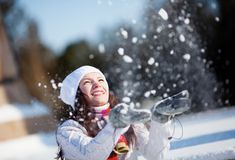 Girl playing with snow Stock Image
