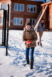 Girl playing in snow Stock Photo