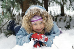 Girl playing in snow. A happy young girl playing in winter snow Royalty Free Stock Photo