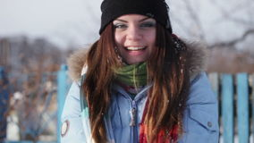 Girl playing with snow stock footage