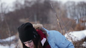 Girl playing with snow stock video