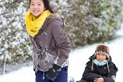Girl playing in the snow in winter in denmark stock photography