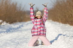 Girl playing on snow Stock Images