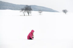 Girl playing with snow. And having fun outdoor Royalty Free Stock Photos