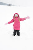Girl playing with snow. And having fun outdoor Stock Images
