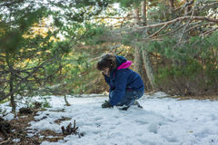 Girl playing with the snow in the hillside Royalty Free Stock Photos