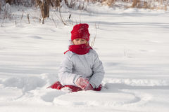 Girl  playing in the snow Stock Photos