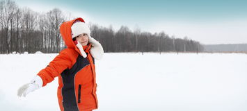 Girl Playing with Snow Outdoors Stock Photos