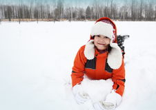 Girl Playing with Snow Outdoors Royalty Free Stock Photo