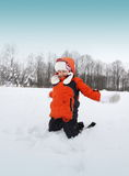 Girl Playing with Snow Outdoors Stock Images