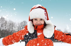 Girl Playing with Snow Outdoors Royalty Free Stock Image