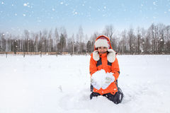 Girl Playing with Snow Outdoors Royalty Free Stock Photos