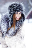 Girl playing with snow Royalty Free Stock Image