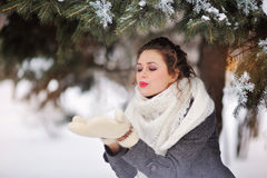 Girl playing with snow in park Royalty Free Stock Image