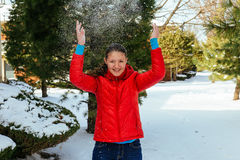Girl playing with snow in park Stock Photos