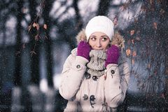 Girl playing with snow in park. Winnter Royalty Free Stock Photography