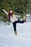 Girl playing with snow in park. Stock Photo