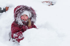 Girl playing with snow in the snow. Royalty Free Stock Photography