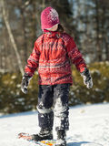 Girl playing in the snow Royalty Free Stock Photography