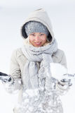 Girl  playing with snow in winter. Royalty Free Stock Photos