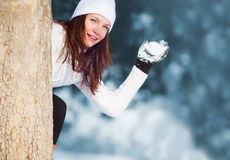 Girl playing with snow Royalty Free Stock Photo