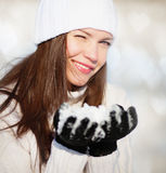 Girl playing with snow Royalty Free Stock Photos