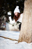 Girl playing with snow Stock Photos