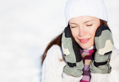 Girl playing with snow Stock Photo
