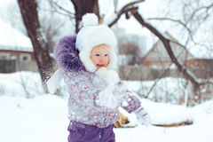 Girl playing snow Stock Images