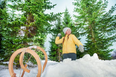Girl playing snowball on the firs background Stock Photography