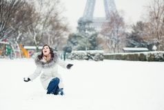 Girl playing snowballs in Paris Royalty Free Stock Photography