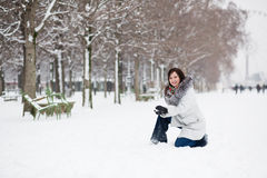 Girl playing snowballs in Tuilleries, Paris Stock Images