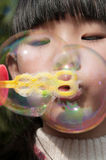 Girl playing soap bubble Royalty Free Stock Photography