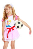 Girl playing with soccer ball Royalty Free Stock Photos