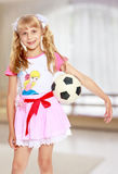 Girl playing with soccer ball Royalty Free Stock Photo