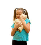 Girl playing with soft teddy bear. Stock Images