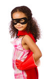 Girl playing super hero. Portrait of pretty mixed race African American girl pretending to be a super hero Royalty Free Stock Photos