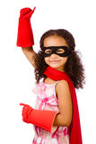 Girl playing super hero. Portrait of pretty mixed race African American girl pretending to be a super hero Royalty Free Stock Images