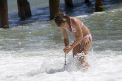 Girl playing in surf  Royalty Free Stock Photography