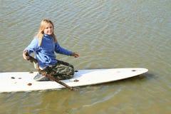Girl playing on surf stock image