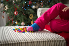Girl playing with sweets on xmas eve Royalty Free Stock Photo