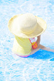 Girl playing in swimming pool Stock Photos