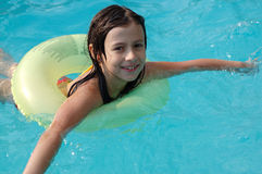 Girl playing in swimming pool Stock Images